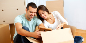 Couple Looking At Contents of Moving Box