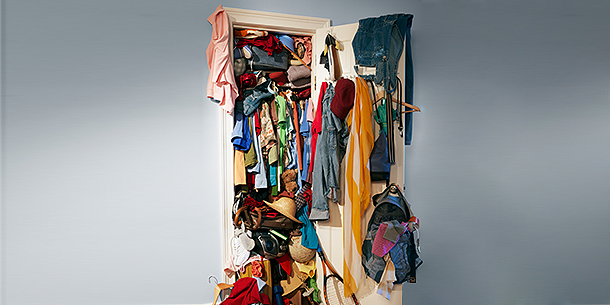 Closet Overflowing With Clothes
