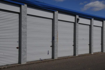 Secure, outdoor storage units with white doors