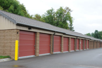 Secure outdoor storage units with red doors